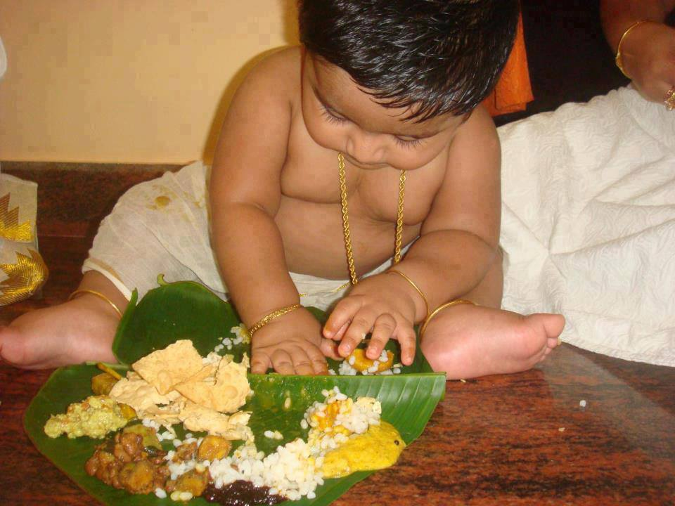 baby eating onam sadya with hands
