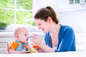 mother-feeding-her-cute-baby-son-giving-him-his-first-solid-food-Ntureloc arrowroot powder