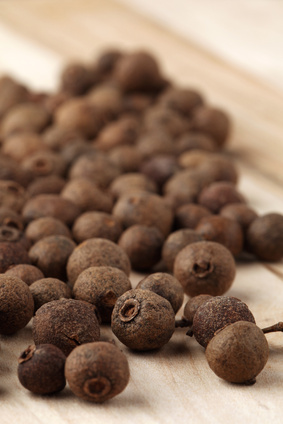 Closeup of allspice on a wooden table. Shallow dof, selective focus